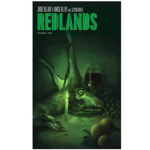 "A dead lizard or dinosaur head lays amidst a still life with a glass of wine and fruit, all tinted green, with the words ""REDLANDS"" across the top in green."