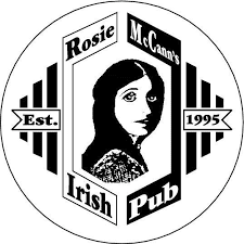 A black and white logo of a young woman with long hair looking over her shoulder towards you, bracketed by art deco lines and frame, and the words Rosie McCann's Irish Pub, Est. 1995