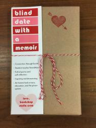"A book wrapped in brown paper, with a red stamp heart, bound with string, and with a bookmark that reads ""blind date with a memoir"""