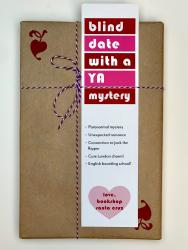 A book wrapped in brown paper, with a white, red, and pink bookmark that says Blind Date with a YA Mystery