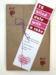 A book wrapped in brown paper, with a white, red, and pink bookmark that says YA Blind Date with a Rake