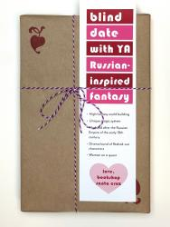 A book wrapped in brown paper, with a white, red, and pink bookmark that says Blind Date with YA Russian-Inspired Fantasy